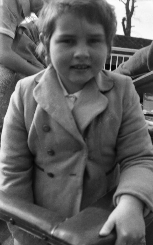 Young girl in coat.