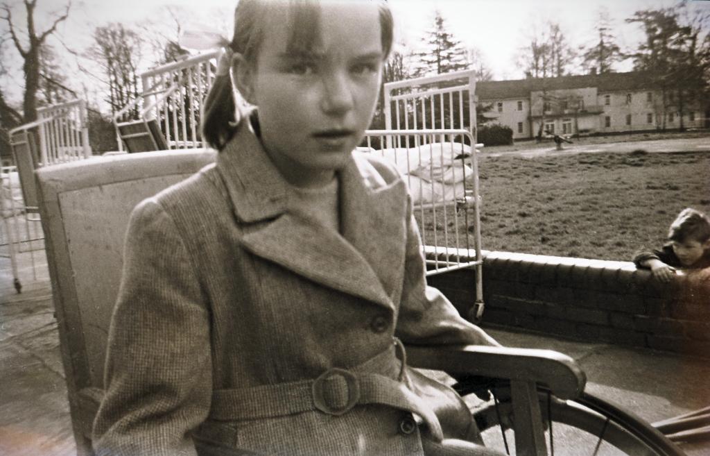 Girl in wheelchair.